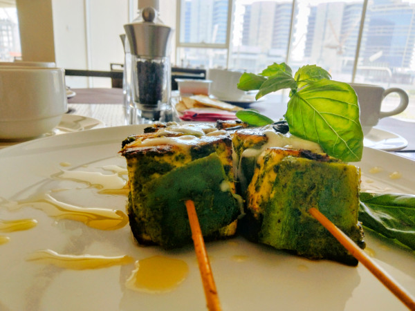 Cheese skewer appetizer with basil pesto