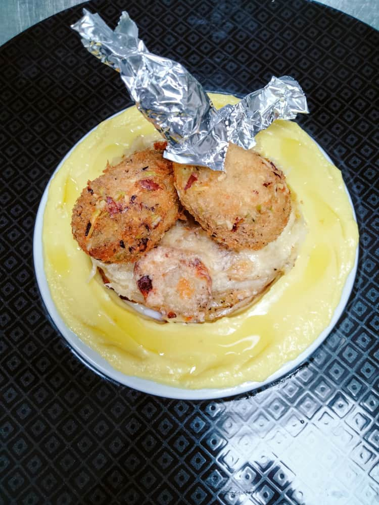 Chicken drumstick with baked potato and saffron sauce